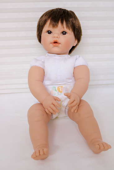 Picture of Magic Baby 1-1 - Brown Hair, Brown Eyes  In White Onsie
