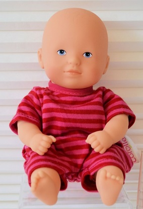 "Picture of f Les Minis ""Calin Graceful""  - Caucasian baby with pink and red outfit"